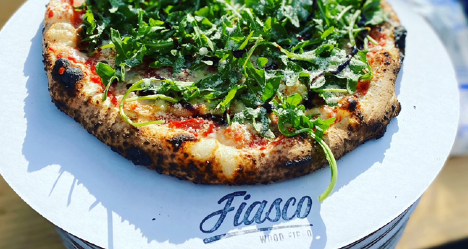 Pizza with arugula greens on top